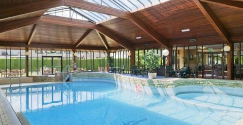 The swimming pool at or near Airport Inn & Spa Manchester