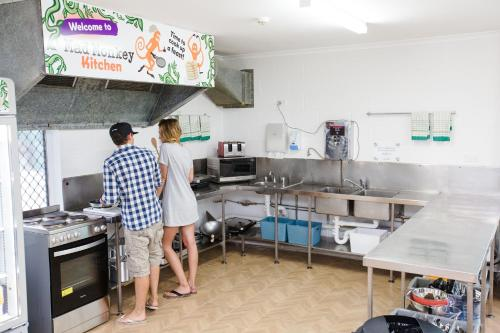 A kitchen or kitchenette at Mad Monkey Backpackers Waterfront