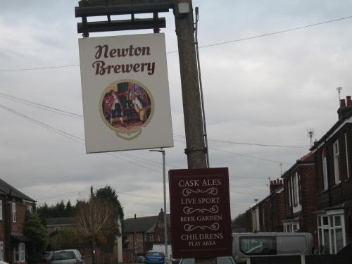 The logo or sign for the inn