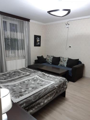 Кровать или кровати в номере Nick&David INN