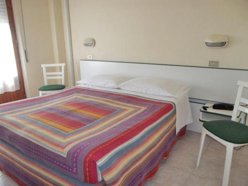 A bed or beds in a room at Albergo Giglio