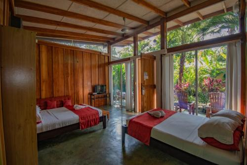 A bed or beds in a room at Fuego Lodge