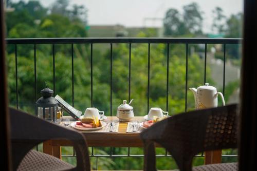 Een balkon of terras bij Ella Rawana Den Hotel