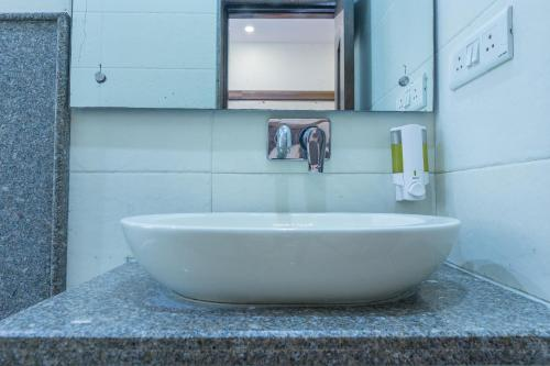 A bathroom at Rupam Hotel