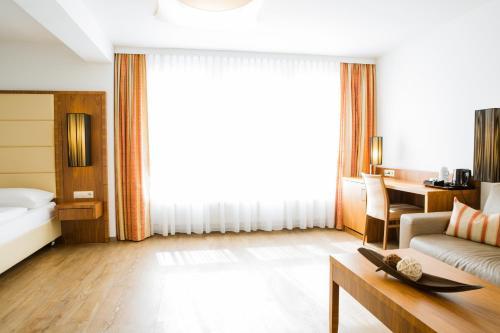 Ein Sitzbereich in der Unterkunft Hotel Kapeller Innsbruck