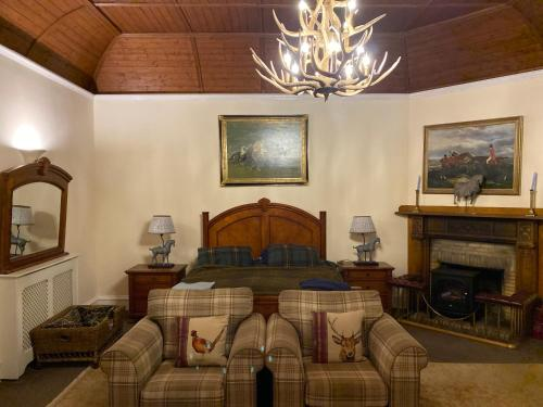 A bed or beds in a room at Ardoch House Boutique Hotel