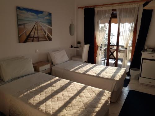 Postel nebo postele na pokoji v ubytování Pension Antonakis