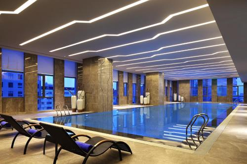 The swimming pool at or near Wanda Realm Hotel Dongying