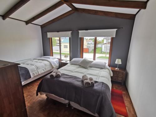 Cama ou camas em um quarto em SHEUEN PATAGONIA