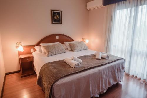 Cama ou camas em um quarto em Hotel Vista do Vale