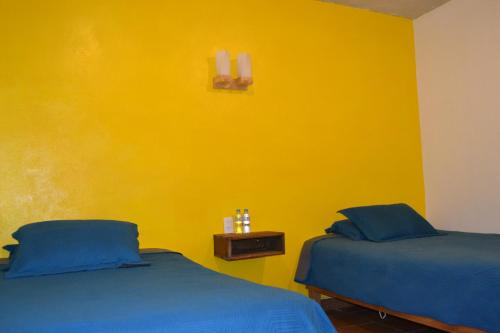 Cama o camas de una habitación en Hotel Quetzalcalli