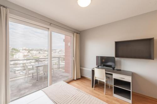 A television and/or entertainment center at City Résidence Marseille