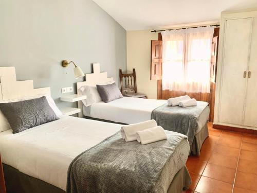 Cama o camas de una habitación en Hotel Rural Tia Margot