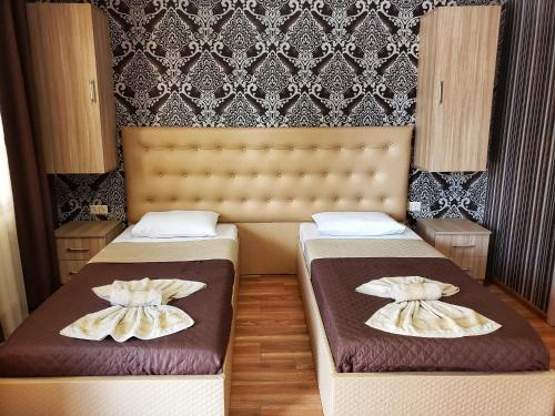 A bed or beds in a room at Oasis Villa