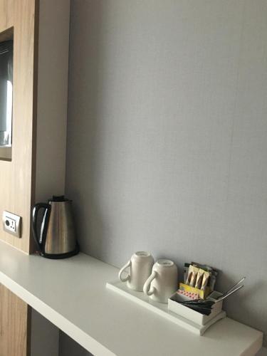Coffee and tea making facilities at Holiday Inn Express Geneva Airport, an IHG Hotel