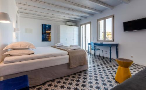 A bed or beds in a room at Milia Gi Suites