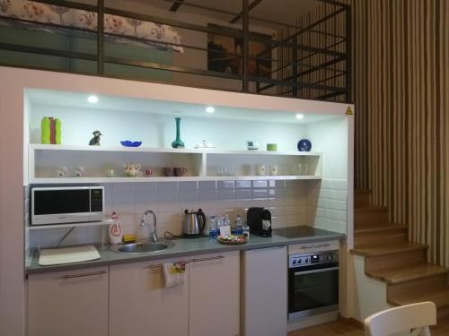A kitchen or kitchenette at Tempo Life Apartman