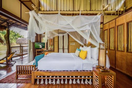 A bed or beds in a room at The Float House River Kwai - SHA Certified