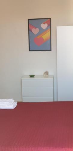 Letto o letti in una camera di appartamento vista mare