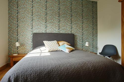 A bed or beds in a room at Les belles vignes