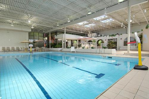 The swimming pool at or near Days Inn by Wyndham Calgary South