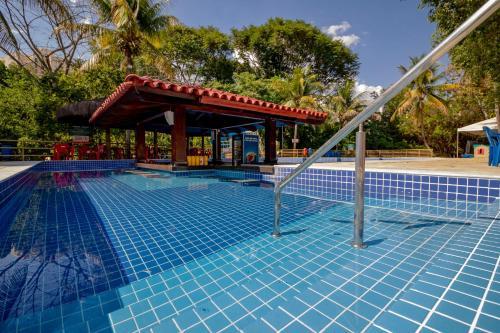 The swimming pool at or near Pousada do Ipê