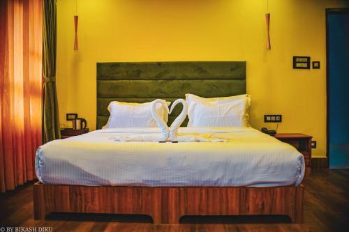 A bed or beds in a room at Golden Kuensel Resort & Spa