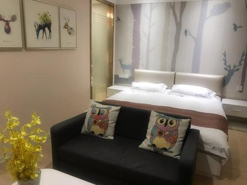 A bed or beds in a room at Genting Star Shanghai