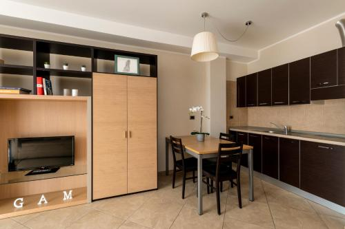 A kitchen or kitchenette at ApartHotel Anghel