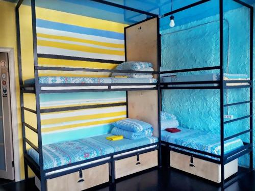 A bunk bed or bunk beds in a room at Riverside Hostel & Tours