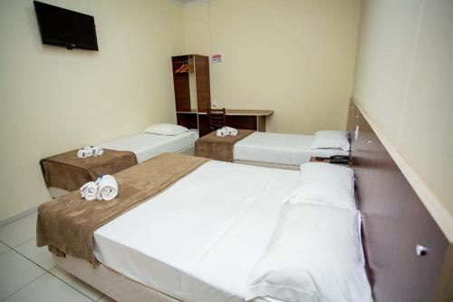 A bed or beds in a room at Hotel Zandoná