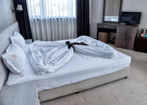 Кровать или кровати в номере Hotel Nove