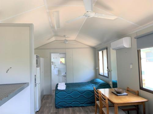 A bed or beds in a room at Ingenia Holidays Noosa North