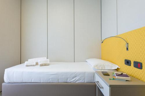 A bed or beds in a room at Camplus Guest Bononia Casa per Ferie