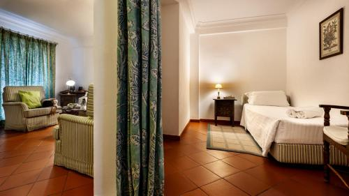 Uma cama ou camas num quarto em Pousada de Marvao