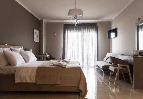 Letto o letti in una camera di Phaedra Suites