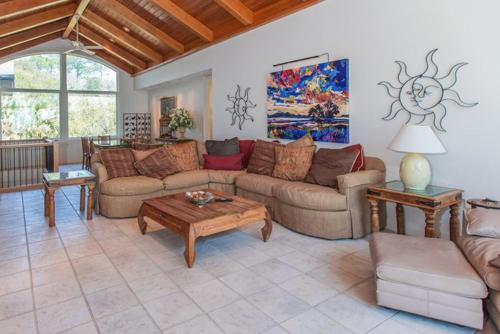 A seating area at All-Suite Oceanfront Oasis with Pool & Hot Tub home