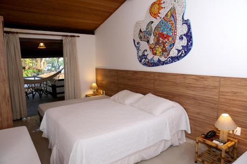 A bed or beds in a room at Pousada Ogum Marinho