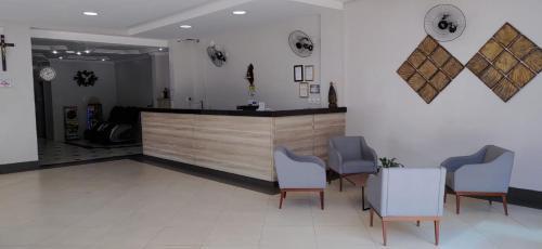 O saguão ou recepção de Hotel Estação de Minas