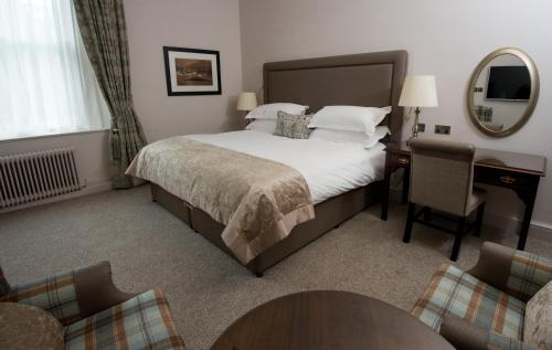A bed or beds in a room at Macdonald Old England Hotel & Spa