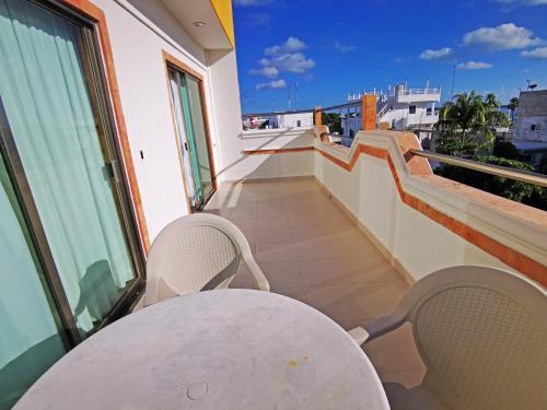 Un balcón o terraza de Hotel Boutique Kinich