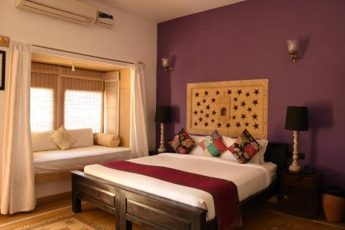 A bed or beds in a room at Mateh Villa