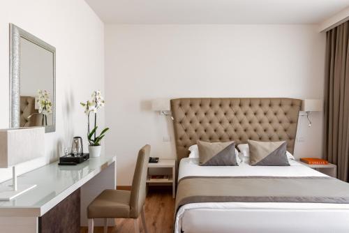 Кровать или кровати в номере UNAWAY Ecohotel Villa Costanza Venezia