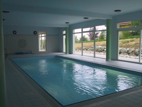 The swimming pool at or near Au Soleil du Sundgau