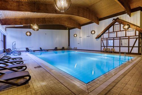 Der Swimmingpool an oder in der Nähe von Sport- & Vital-Resort Neuer Hennings Hof
