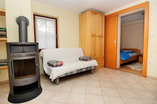 Postelja oz. postelje v sobi nastanitve Ekološka turistična kmetija pri Lovrču