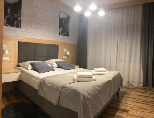 Łóżko lub łóżka w pokoju w obiekcie Vektron