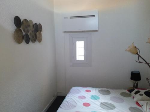 A bed or beds in a room at Duplex vieux port - mesures sanitaires supplémentaires