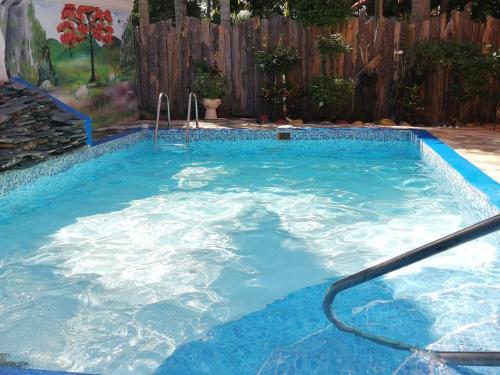The swimming pool at or near La famosa costillas a la leña