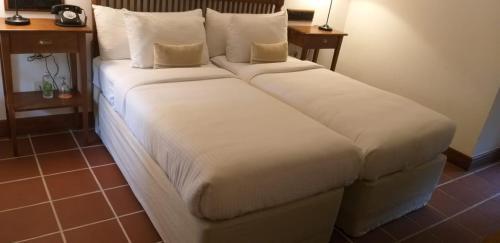 A bed or beds in a room at EKHO Sigiriya